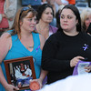 Gloucester:  Lourie Paterno, holds a picture of her son Michael Rogers who passed away last year. Came together with her daughter Roseanne El Amine and friends to remember those who died from heroin,in a candle light vigil ceremony held last night on the Boulevard. Desi Smith /Gloucester Daily Times. August 31,2011