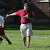 David Le/Gloucester Daily Times. New Gloucester head football coach Tony Zerilli shouts instructions at his team on Monday afternoon at the teams' first practice of the season. 8/22/11.