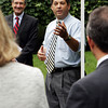 David Le/Gloucester Daily Times. State Senator Bruce Tarr speaks to a small crowd gathered on the lawn of Stephanie East's home in Gloucester on Tuesday morning while Jeffrey Simon, Director of the Massachusetts Recovery and Reinvestment Office, looks on. Stephanie East is the homeowner of the 10,000th house being weatherized under the Recovery and Reinvestment Act. 8/16/11.