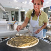 Gloucester: Mahroussie Jabba of Gloucester, front, prepares  Lebanese markouk  on a saj, during the 54th annual Gloucester Sidewalk Bazaar. Jim Vaiknoras/staff photo