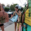ALLEGRA BOVERMAN/Gloucester Daily Times Some of the recycled rice bags that are sold at Kiss on the Neck ice cream in Rocky Neck by Richard Ross of Rocky Neck. The bags are made in Senegal. From left: sisters Nichole and Danielle Geary of Rochester, N.Y., both longtime summer residents of Gloucester, selected and bought bags on Tuesday evening at the shop.
