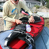 MARIA UMINSKI/Gloucester Daily Times. Bob Turfley of Gloucester readies his kayak before heading out into the open waters at Conomo Point in Essex.