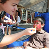 Gloucester:Gloucester high student  Liz Murphy paints a Spiderman face on ustin Boushie, 4,during the 54th annual Gloucester Sidewalk Bazaar.Liz and her fellow thespians were raisning money fow the high school drama dept. Jim Vaiknoras/staff photo