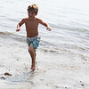 MARIA UMINSKI/Gloucester Daily Times. Six-year-old Stephen Martin of Manchester charges out of the water at White Beach in Manchester to avoid running into any seaweed.