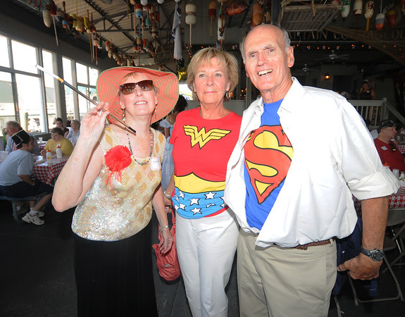 Gloucester:Director of Adult Foster Care of the North Shore Cynthia Bojarlieposes with Judge David and  Michele Harrison at a Hollywood themed costume lunchen at the Gloucester House Monday afternoon. Jim Vaiknoras/staff photo