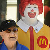 Jim Vaiknoras/Gloucester Daily Times. Buzz Bertolino poses with Ronald McDonald at the grand reopening of the Maplewood Street McDonalds in Gloucester Wednesday morning. Buzz has been coming to this McDonalds 3 times a day for the past 23 years, since it first opened.
