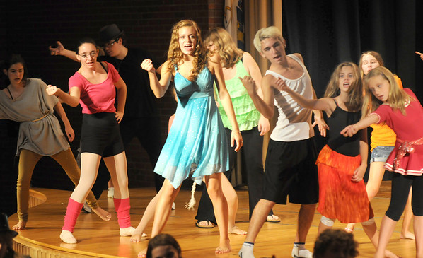 """Jim Vaiknoras/Gloucester Daily Times. Performers belt out a song in rehearsal for """"Fame Junior""""  with O'Maley Middle School Drama Camp Thursday. The performance is at noon on Friday, at the Middle School, admission is free."""