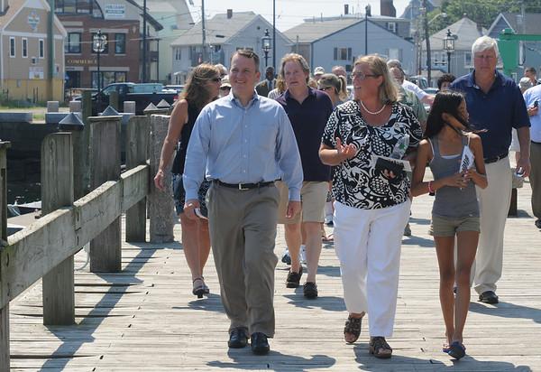 JIm Vaiknoras/Gloucester Daily Times. Gloucester Mayor Carolyn Kirk and Lt. Gov. Tim Murray walk along the Harbor Walk in Gloucester Thursday.