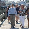 JIm Vaiknoras/Gloucester Daily Times. Gloucester Mayor Carolyn Kirk and Lt. Gov. Tim Murray walk along the Harbor Walk in Gloucester Thursday.