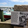 ALLEGRA BOVERMAN/Staff photo. Gloucester Daily Times. Gloucester: A lobster-related marker near parked lobster boats along the boardwalk at St. Peter's Square that is part of the new HarborWalk.