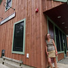 ALLEGRA BOVERMAN/Gloucester Daily Times Anne Marie Crotty of Flatrocks Gallery, outside the newly rebuilt and expanded multipurpose building.