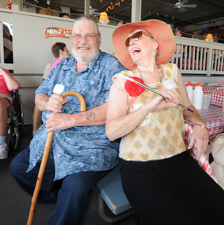 Gloucester:Director of Adult Foster Care of the North Shore Cynthia Bojarlie shares a laugh with Albert Hill at a Hollywood themed costume lunchen at the Gloucester House Monday afternoon. Jim Vaiknoras/staff photo