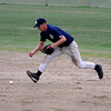 Jim Vaiknoras/Gloucester Daily Times: <br />  Manchester's Mike Cain field a grounder during the teams game against Ipswich  in the  ITL baseball finals at Memorial Field in Essex Wednesday night.