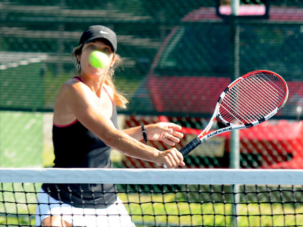Gloucester: Erin Canniff  who is partnered with Mary Ann Shatford return a shot during their match against Jenny Muzio and Pam Choi atthe Bass Rocks women's tennis tournament Monday. Jim Vaiknoras/staff photo