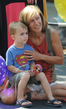 Gloucester:Jack Araneo, 3,of Gloucester and Nan araneo of Rockport watch the magical stylings of Brian Christie during the 54th annual Gloucester Sidewalk Bazaar. Jim Vaiknoras/staff photo