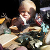 ALLEGRA BOVERMAN/Staff photo. Gloucester Daily Times. Gloucester: Dahlia Newman, 16 months old, and a resident of Rocky Neck, plays with treasures such as shells, rocks, and little statues in her windowsill on Monday afternoon.