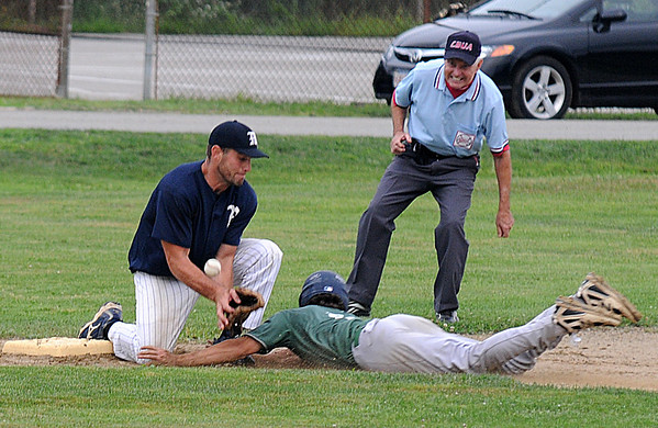 Jim Vaiknoras/Gloucester Daily Times: <br />  Manchester's Christian Maki can't get the tag down as Ipswich's Mark O'Flynn steals third during their game in the  ITL baseball finals at Memorial Field in Essex Wednesday night.