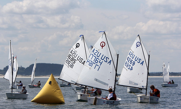 ALLEGRA BOVERMAN/Gloucester Daily Times Participants reach and round a float in the Championship Optimus race off Wingaersheek Beach on Monday. The Annisquam Yacht Club is hosting the three-day-long Junior Olympic Sailing Festival.