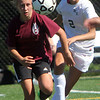 ALLEGRA BOVERMAN/Gloucester Daily Times From left is Gloucester's Ariana Dietzel in action against Manchester-Essex's Sarah Lewiecki during their scrimmage in Manchester on Wednesday afternoon. Gloucester beat M-E 2-1 in overtime.