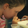 "JIm Vaiknoras/Gloucester Daily Times. Ella Costa, 6, paints a cup shaped like an owl at the "" Give A Hoot"" summer art program at Glazed in Gloucester for kids in Kindergarten through 8th grade held tuesdays through friday mornings."