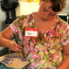 Rockport  : Kyra Sieben , 9, paints her sculptures at the Rockport Art Association inspired by glassblower Dale Chihuly, the class is being taught by artist Erin O'Sullivan through out th eweek. Jim Vaiknoras/staff photo