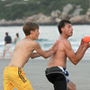 Jim Vaiknoras/Gloucester Daily Times: Nathan Mente makes a catch while being covered by Nate Shepard in a game playing a game of touch football on Good Harbor Beach this past week. It was Nathan's son Andrew's 16th birthday and he wanted to play 2 on 2 football with his friends Nate and John Dyer and his dad.