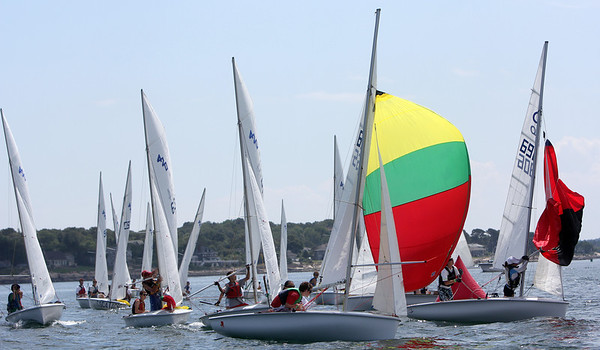 ALLEGRA BOVERMAN/Gloucester Daily Times Participants in the 420 Champions hoist their spinnakers as they reach and round a float during their race off Wingaersheek Beach on Monday. The Annisquam Yacht Club is hosting the three-day-long Junior Olympic Sailing Festival.