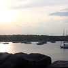 MARIA UMINSKI/Gloucester Daily Times. Sailboats and yachts crowd the cove on back side of Bearskin Neck in Rockport Harbor after a New York Yacht Club group assended on the sea-side town as part of a club trip.