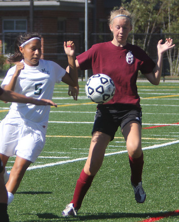 ALLEGRA BOVERMAN/Gloucester Daily Times Manchester-Essex player Mari Ansara, left, in action with Gloucester's Kerri Colby<br /> during their scrimmage against Gloucester High School on Wednesday afternoon in Manchester. Gloucester beat M-E 2-1 in overtime.
