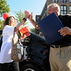 Jim Vaiknoras/Gloucester Daily Times. Linda Shoids of Gloucester high fives owner Charles Lietz after winning a Chevy Sonic at the grand reopening of the Maplewood Street McDonalds in Gloucester Wednesday morning.