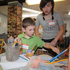Rockport  : Benjamin Bazdargets some help from Samatha Poole  as he works on his sculpture at the Rockport Art Association inspired by glassblower Dale Chihuly, the class is being taught by artist Erin O'Sullivan through out the week. Jim Vaiknoras/staff photo