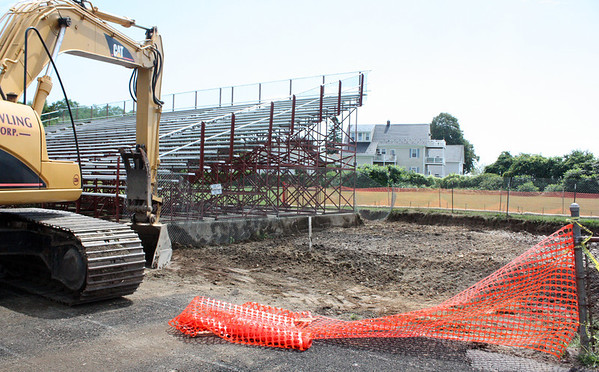MARIA UMINSKI/Gloucester Daily Times. A work crew removed contaminated soil from Newell Stadium which will be getting a new FieldTurf artificial surface in time for the 2013 football season. This season the team will play its home games at Manchester-Essex. The Newell Stadium Building Committee this week selected a low bidder for the contract, which requires work to begin by September and be completed by next June.