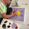 "ALLEGRA BOVERMAN/Gloucester Daily Times Members of the Art Club at Pathways for Children. Finishing up her canvas that will be auctioned at the upcoming ""A Place at the Table"" Gala in November is Taylah Baseman, 10."