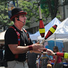 Gloucester: Brian Christie walks backward up a ladder while juggling 3 clubs during the 54th annual Gloucester Sidewalk Bazaar. Jim Vaiknoras/staff photo