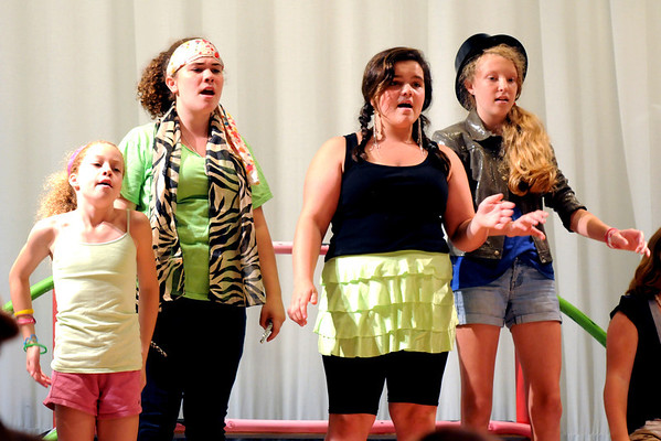 """Jim Vaiknoras/Gloucester Daily Times. Hope Miller, Amy Garity, Talia Dewolfe, and Sierra Rudolph in rehearsal for """"Fame Junior""""  with O'Maley Middle School Drama Camp Thursday. The performance is at noon on Friday, at the Middle School, admission is free."""