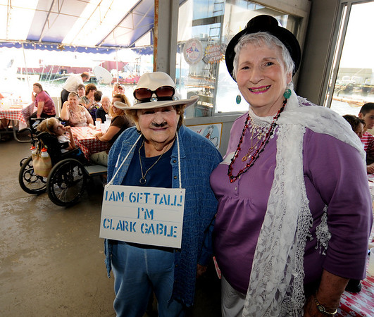 Gloucester:Constance Baker dressed as Clark Gable and Ruth Belliveau dressed as Olympia Dukakis paose at a Hollywood themed costume lunchen at the Gloucester House for Adult Foster Care of the North Shore  Monday afternoon. Jim Vaiknoras/staff photo