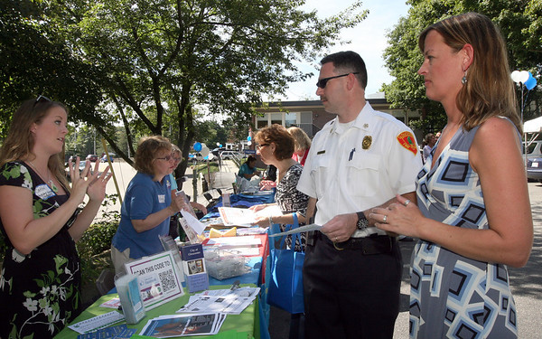 ALLEGRA BOVERMAN/Gloucester Daily Times New Gloucester Fire Chief <br /> Eric Smith, second from left, was on hand for the Gloucester Family Health Center Open House as part of National Health Center Week on Wednesday. He was talking with representatives from Healthy Gloucester Collaborative, including, from far left: Caitlin Kreitman and Kathy Day, far right.