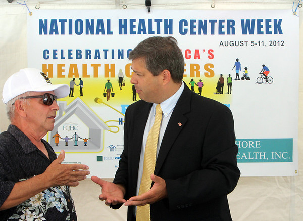 ALLEGRA BOVERMAN/Gloucester Daily Times Sen. Bruce Tarr, right, talks <br /> with George W. Carr of Gloucester about how much he likes the Gloucester Family Health Center over the VA. They were participating in the hand for the Gloucester Family Health Center Open House as part of National Health Center Week on Wednesday.