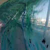 "ALLEGRA BOVERMAN/Gloucester Daily Times. Addison Burton, 4, plays among the billowing pieces of silk chiffon and organza printed with seaweed designs during a collograph workshop at Maritime Gloucester on Wednesday. Lanesville artist Camilla MacFadyen held a two-day workshop at Maritime Gloucester about collograph printmaking. Students collected seaweed at the pier in back of the museum, made plates by gluing the seaweed to cardboard pieces and applied fabric paint to the three-dimensional surface to print onto dozens of yards of silk chiffon and organza to make a collaborative art installation piece for the museum. The museum also provided fish to create prints from onto fabric and stuffed fish were sewed to swim in the silky virtual aquarium of seaweed images. A ""Stock the Tank"" party that highlighted the group art piece was held on August 18, and the installation will be on view for the rest of the month at Maritime Gloucester. See their website for museum hours at <a href=""http://maritimegloucester.org/"">http://maritimegloucester.org/</a>"