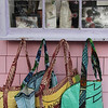 ALLEGRA BOVERMAN/Gloucester Daily Times Some of the recycled rice bags that are sold at Kiss on the Neck ice cream in Rocky Neck by Richard Ross of Rocky Neck, seen in the window. The bags are made in Senegal.