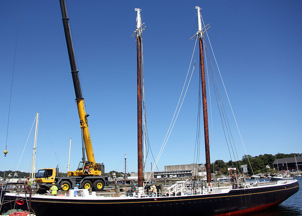 ALLEGRA BOVERMAN/Gloucester Daily Times The Schooner Adventure's masts were reinstalled on Wednesday morning at the Gloucester Marine Railways with the help of Mayer Tree Service personnel and their crane.