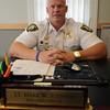 Jim Vaiknoras/Gloucester Daily Times: <br /> Rockport's first ever lieutenant, Mark Schmink at his desk at the Rockport Police Dept.