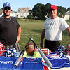 MARIA UMINSKI/Gloucester Daily Times. President and Vice President of the Gloucester Patriots Youth Program, Mike Turner and Kevin Verga, display the new uniforms for youth basketball, softball, cheerleading and football after the name change from Gloucester Raiders to the Gloucester Patriots.