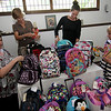 ALLEGRA BOVERMAN/Gloucester Daily Times. Wellspring House is going to be distributing 58 backpacks filled with school supplies to families in the area who are being reconnected to the community following homelessness in the last 12 months and to Northeast Behavioral Health. Many of the backpacks were donated by Boston lawfirm Bingham McCutchen and St. Paul's Church in Hamilton, as well as other local donors. With some of the backpacks are, from left: Sarah Campbell, director of shelter services, Mary Scofield, career and education advisor, Katie Misuraca, development associate, and Leia Sturtevant, a first jobs intern.