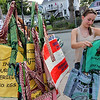 ALLEGRA BOVERMAN/Gloucester Daily Times Some of the recycled rice bags that are sold at Kiss on the Neck ice cream in Rocky Neck by Richard Ross of Rocky Neck. The bags are made in Senegal. From left: Danielle Geary, right, of Rochester, N.Y., and her sister Danielle Geary, now of New York City, both longtime summer residents of  Gloucester, were selecting and bought bags on Tuesday evening at the shop.
