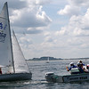 ALLEGRA BOVERMAN/Gloucester Daily Times 420 Champions participants Grace Papp and Peter Thibodeau of Annisquam Yacht Club get advice from their coaches in between races off Wingaersheek Beach on Monday. The Annisquam Yacht Club is hosting the three-day-long Junior Olympic Sailing Festival.
