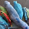 "ALLEGRA BOVERMAN/Gloucester Daily Times. Lanesville artist Camilla MacFadyen held a two-day workshop at Maritime Gloucester about collograph printmaking. Students collected seaweed at the pier in back of the museum, made plates by gluing the seaweed to cardboard pieces and applied fabric paint to the three-dimensional surface to print onto dozens of yards of silk chiffon and organza to make a collaborative art installation piece for the museum. The museum also provided fish to create prints from onto fabric and stuffed fish like these were sewed to swim in the silky virtual aquarium of seaweed images. A ""Stock the Tank"" party that highlighted the group art piece was held on August 18, and the installation will be on view for the rest of the month at Maritime Gloucester. See their website for museum hours at <a href=""http://maritimegloucester.org/"">http://maritimegloucester.org/</a>"