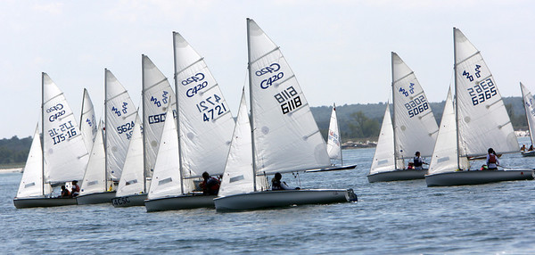 ALLEGRA BOVERMAN/Gloucester Daily Times Participants in the 420 Champions race set off on their race route off Wingaersheek Beach on Monday. The Annisquam Yacht Club is hosting the three-day-long Junior Olympic Sailing Festival.