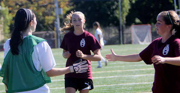 ALLEGRA BOVERMAN/Gloucester Daily Times From left are Gloucester's Riley Gately, Laura Johnson, and Michelle Quinn after their scrimmage in Manchester on Wednesday afternoon. Gloucester beat M-E 2-1 in overtime.