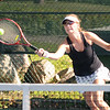 Gloucester Mary Ann Shatford who is partnered with Erin Canniff return a shot during their match against Jenny Muzio and Pam Choi atthe Bass Rocks women's tennis tournament Monday. Jim Vaiknoras/staff photo